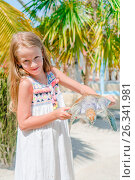 Купить «Little adorable girl with a small turtle in her hands in the reserve», фото № 26341981, снято 10 апреля 2017 г. (c) Дмитрий Травников / Фотобанк Лори