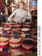 Купить «Young woman buying dried beans», фото № 26344689, снято 15 ноября 2018 г. (c) Яков Филимонов / Фотобанк Лори