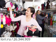Adult woman holding different brassiere in hands. Стоковое фото, фотограф Яков Филимонов / Фотобанк Лори