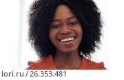 Купить «happy smiling african american young woman face», видеоролик № 26353481, снято 23 марта 2017 г. (c) Syda Productions / Фотобанк Лори