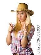 Attractive young woman in cowboy dress and hat, фото № 26358933, снято 6 июля 2011 г. (c) Tatjana Romanova / Фотобанк Лори