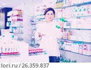 Купить «Positive female pharmacist offering products», фото № 26359837, снято 31 января 2017 г. (c) Яков Филимонов / Фотобанк Лори