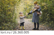 Купить «Mother and her daughter little girl walking in a autumn park - playing with Teddy Bear», фото № 26360005, снято 23 июня 2018 г. (c) Константин Шишкин / Фотобанк Лори