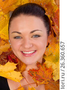 Купить «Close up of woman face in autumn leaves», фото № 26360657, снято 3 октября 2012 г. (c) Tatjana Romanova / Фотобанк Лори