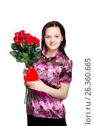 Купить «Beautiful young woman with a bouquet of red roses», фото № 26360665, снято 22 января 2012 г. (c) Tatjana Romanova / Фотобанк Лори