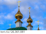 Gold-plated domes with crosses of the Orthodox church. Стоковое фото, фотограф Вадим Бочкарев / Фотобанк Лори