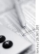 Купить «Калькулятор и ручка на газете с финансовыми новостями», фото № 26361201, снято 14 сентября 2011 г. (c) Александр Гаценко / Фотобанк Лори