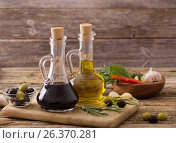 Купить «olive oil flavored with spices and other ingredients», фото № 26370281, снято 24 ноября 2016 г. (c) Майя Крученкова / Фотобанк Лори