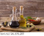Купить «olive oil flavored with spices and other ingredients», фото № 26370281, снято 24 ноября 2016 г. (c) Майя Крученкова / Фотобанк Лори