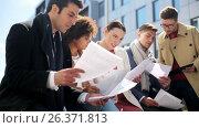 Купить «international business team with papers outdoors», видеоролик № 26371813, снято 27 февраля 2020 г. (c) Syda Productions / Фотобанк Лори