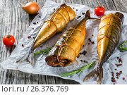 Купить «Smoked fish Mackerel or Scombe, top view», фото № 26376769, снято 16 января 2019 г. (c) Oksana Zh / Фотобанк Лори