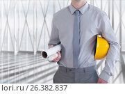 Купить «An architect is holding plan and a safety helmet», фото № 26382837, снято 15 августа 2018 г. (c) Wavebreak Media / Фотобанк Лори