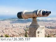 Купить «BARCELONA, SPAIN - JULY 13, 2016: Binoculars overlooking Barcelona skyline», фото № 26385197, снято 13 июля 2016 г. (c) Papoyan Irina / Фотобанк Лори