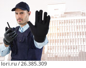 Купить «Security guard with walkie talkie and hand up against faded buildings», фото № 26385309, снято 18 января 2019 г. (c) Wavebreak Media / Фотобанк Лори