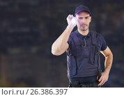 Купить «Security man outside in night city», фото № 26386397, снято 16 ноября 2019 г. (c) Wavebreak Media / Фотобанк Лори