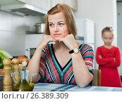 Купить «Upset girl and mother have a peeve on each other», фото № 26389309, снято 10 июля 2020 г. (c) Яков Филимонов / Фотобанк Лори