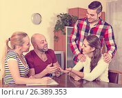 Купить «spouses sitting with documents and asking friends for advice», фото № 26389353, снято 16 июля 2019 г. (c) Яков Филимонов / Фотобанк Лори