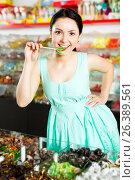 Купить «Woman posing to photographer with lollypop», фото № 26389561, снято 25 апреля 2017 г. (c) Яков Филимонов / Фотобанк Лори