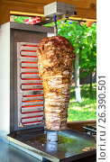 Купить «Traditional fast food Turkish doner kebab meat on a rotary grill», фото № 26390501, снято 27 мая 2017 г. (c) FotograFF / Фотобанк Лори