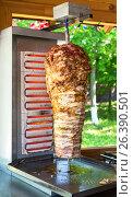 Купить «Traditional fast food Turkish doner kebab meat on a rotary grill», фото № 26390501, снято 27 мая 2017 г. (c) FotograFF / Фотобанк Лори