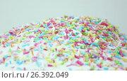 Sprinkle for Easter cakes. Стоковое видео, видеограф Потийко Сергей / Фотобанк Лори