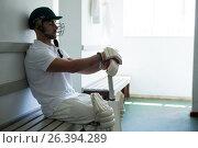 Close up of cricket player sitting on bench. Стоковое фото, агентство Wavebreak Media / Фотобанк Лори