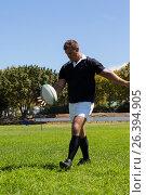 Купить «Player kicking rugby ball on grassy field», фото № 26394905, снято 9 февраля 2017 г. (c) Wavebreak Media / Фотобанк Лори
