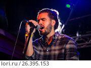Купить «Man singing on microphone», фото № 26395153, снято 7 марта 2017 г. (c) Wavebreak Media / Фотобанк Лори