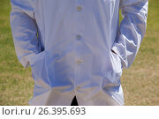 Mid section of cricket umpire standing with hands in pockets. Стоковое фото, агентство Wavebreak Media / Фотобанк Лори