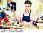 Купить «Joiner working in workshop», фото № 26396305, снято 8 апреля 2017 г. (c) Яков Филимонов / Фотобанк Лори