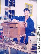 Купить «Restorer of furniture in workroom», фото № 26396321, снято 8 апреля 2017 г. (c) Яков Филимонов / Фотобанк Лори