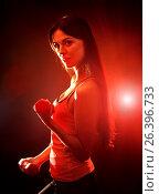 Купить «Fitness girl exercising in gym with dumbbells.», фото № 26396733, снято 13 августа 2016 г. (c) Gennadiy Poznyakov / Фотобанк Лори