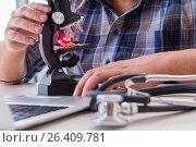 Купить «High precision engineering with man working with microscope», фото № 26409781, снято 28 февраля 2017 г. (c) Elnur / Фотобанк Лори