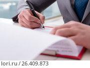 Купить «Businessman taking notes at the meeting», фото № 26409873, снято 2 марта 2017 г. (c) Elnur / Фотобанк Лори