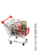 Купить «Деньги в маленькой продуктовой тележке на белом фоне», фото № 26409925, снято 4 июня 2011 г. (c) Александр Гаценко / Фотобанк Лори