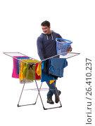 Купить «Husband man doing laundry isolated on white», фото № 26410237, снято 6 марта 2017 г. (c) Elnur / Фотобанк Лори