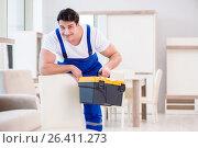 Купить «Furniture repairman working in store», фото № 26411273, снято 23 марта 2017 г. (c) Elnur / Фотобанк Лори