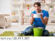 Купить «Man at home dealing with neighbor flood leak», фото № 26411381, снято 24 марта 2017 г. (c) Elnur / Фотобанк Лори