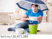 Купить «Man at home dealing with neighbor flood leak», фото № 26411389, снято 24 марта 2017 г. (c) Elnur / Фотобанк Лори