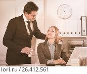 Купить «Sexual harassment between colleagues», фото № 26412561, снято 20 апреля 2017 г. (c) Яков Филимонов / Фотобанк Лори