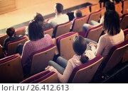 Купить «Happy audience expecting movie to begin», фото № 26412613, снято 3 декабря 2016 г. (c) Яков Филимонов / Фотобанк Лори