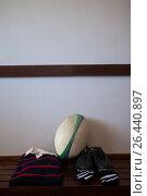 Купить «Rugby ball with clothes and shoes», фото № 26440897, снято 9 февраля 2017 г. (c) Wavebreak Media / Фотобанк Лори