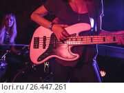 Купить «Female guitarist playing guitar with drummer in nightclub», фото № 26447261, снято 7 марта 2017 г. (c) Wavebreak Media / Фотобанк Лори