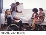 Купить «Disabled female executive with team planning in creative office», фото № 26448845, снято 19 марта 2017 г. (c) Wavebreak Media / Фотобанк Лори