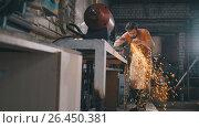 Купить «Blacksmith in forge - sharpening iron tools with sparkles - metal workshop», фото № 26450381, снято 20 апреля 2018 г. (c) Константин Шишкин / Фотобанк Лори