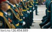 Купить «DONETSK, UKRAINE- 9 May 2017: Officers marching on parade», видеоролик № 26454889, снято 26 мая 2017 г. (c) Илья Шаматура / Фотобанк Лори