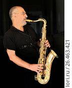 Купить «Saxophone player dressen in black in front of a black background», фото № 26463421, снято 15 февраля 2006 г. (c) age Fotostock / Фотобанк Лори