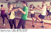 Купить «People learning swing at dance class», фото № 26475537, снято 24 октября 2018 г. (c) Яков Филимонов / Фотобанк Лори