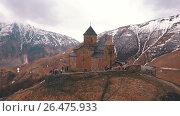 Купить «Gergeti Trinity Church in the mountains of the Caucasus», видеоролик № 26475933, снято 4 июня 2017 г. (c) Виктор Аллин / Фотобанк Лори