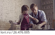 Купить «Child and adult in a creative workshop», видеоролик № 26476005, снято 21 января 2020 г. (c) Raev Denis / Фотобанк Лори